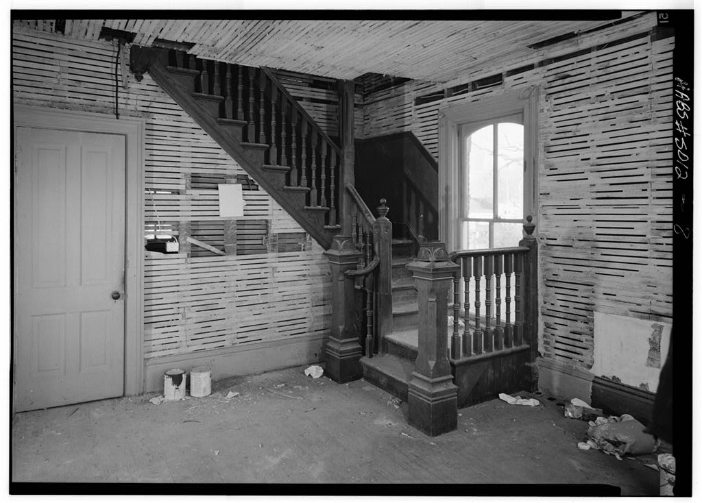 A Victorian interior staircase of the Austin-Whittemore House.