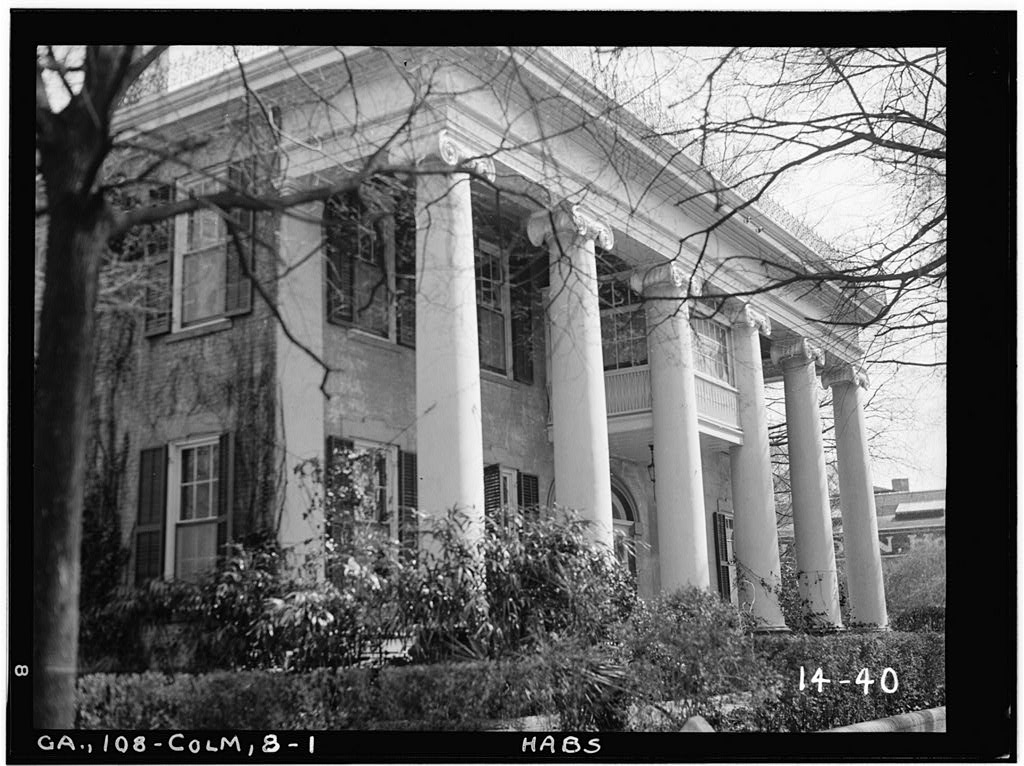 A view of the front facade of the historic Greek Revival Fontaine House.