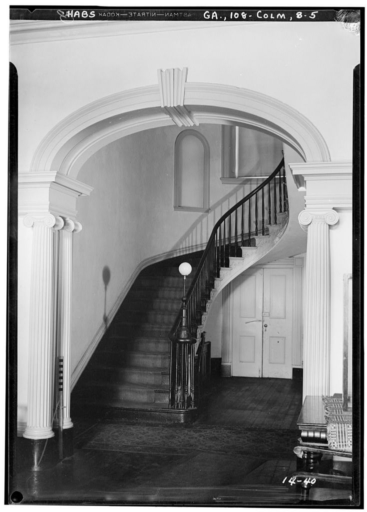 Grand staircase and foyer inside the Greek Revival Fontaine House.