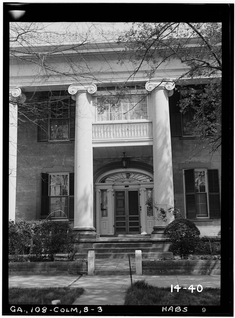 Greek Revival ionic columns on the facade of the Fontaine House.