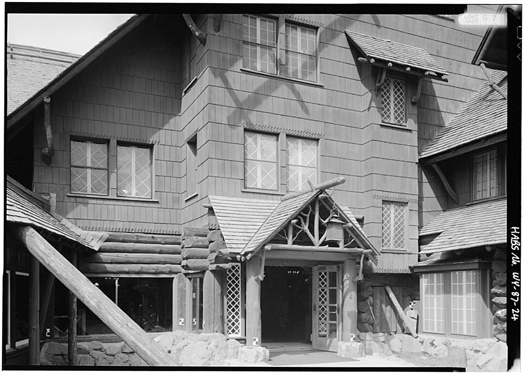 Rustic arts & crafts exterior porch of the Yellowstone's incredible 1903 Old Faithful Inn.