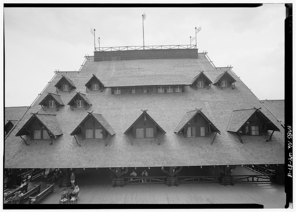 Dramatic roofline flying flags of Yellowstone's Old Faithful Inn.