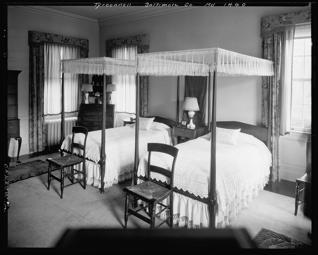 Twin antique American canopy beds inside Baltimore's Tyrconnell House.
