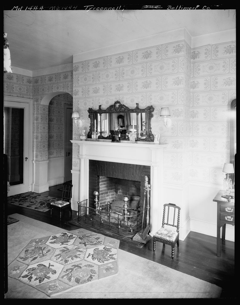 Fireplace with beautiful over mantel mirror inside Baltimore's Tyrconnell House.