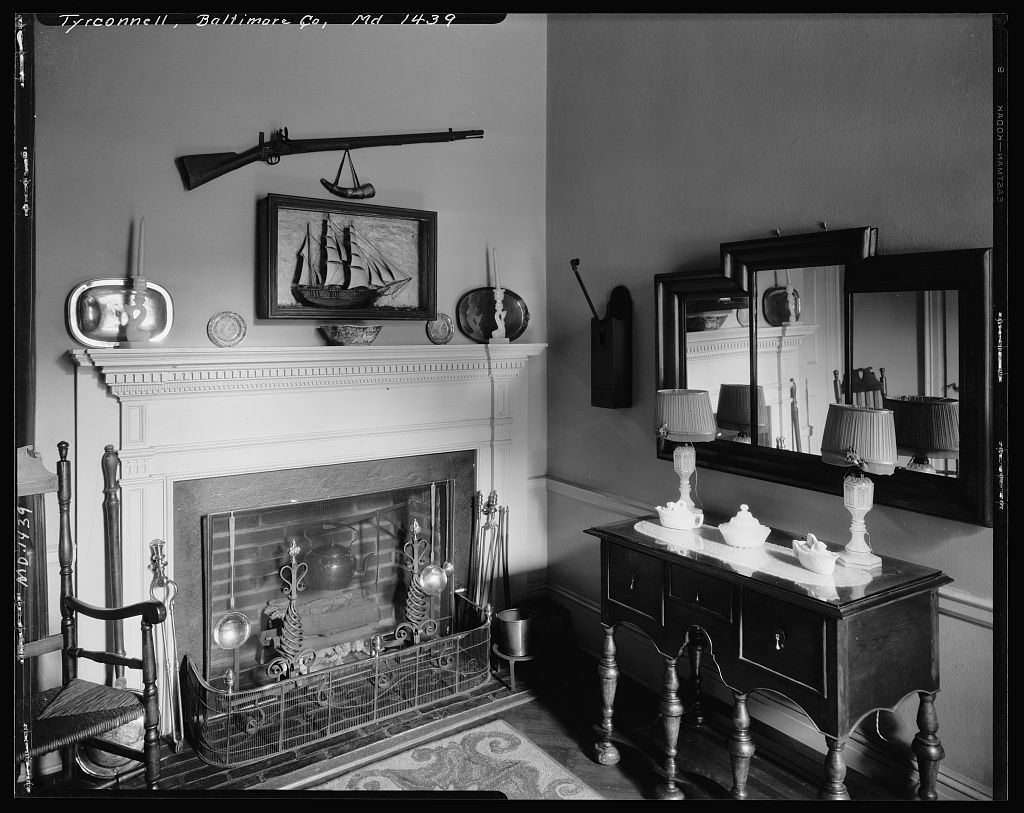 Small parlor with elaborate antique fireplace mantle inside Baltimore's Tyrconnell House.