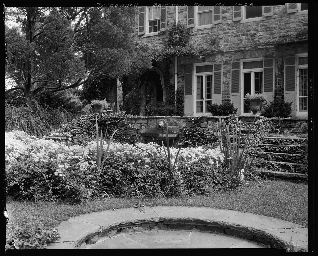 Ivy covered stone garden front of Baltimore's Tyrconnell House.